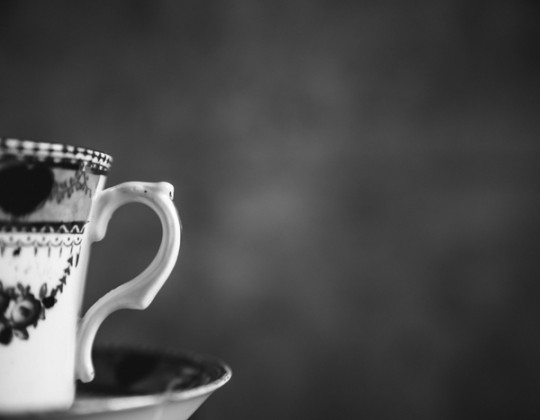 Black and white still life photo of a vintage teacup